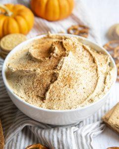 A bowl of pumpkin cheesecake dip.