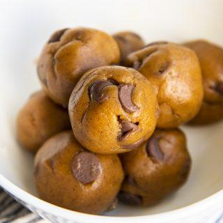 Chocolate Chip Pumpkin Cookie Dough balls in a white bowl.