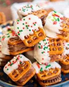 A close up of a plateful of candy bar pretzel bites.