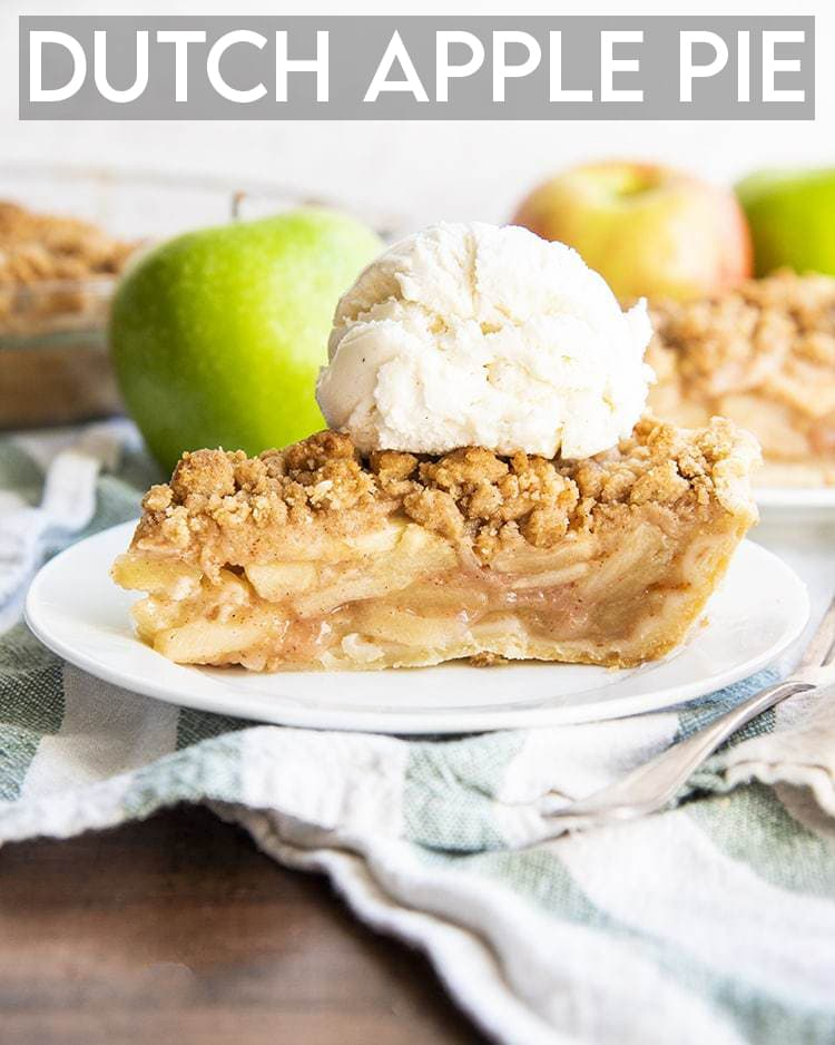 A slice of apple pie on a white plate, topped with vanilla ice cream, with apples behind it with a text overlay saying Dutch Apple Pie.
