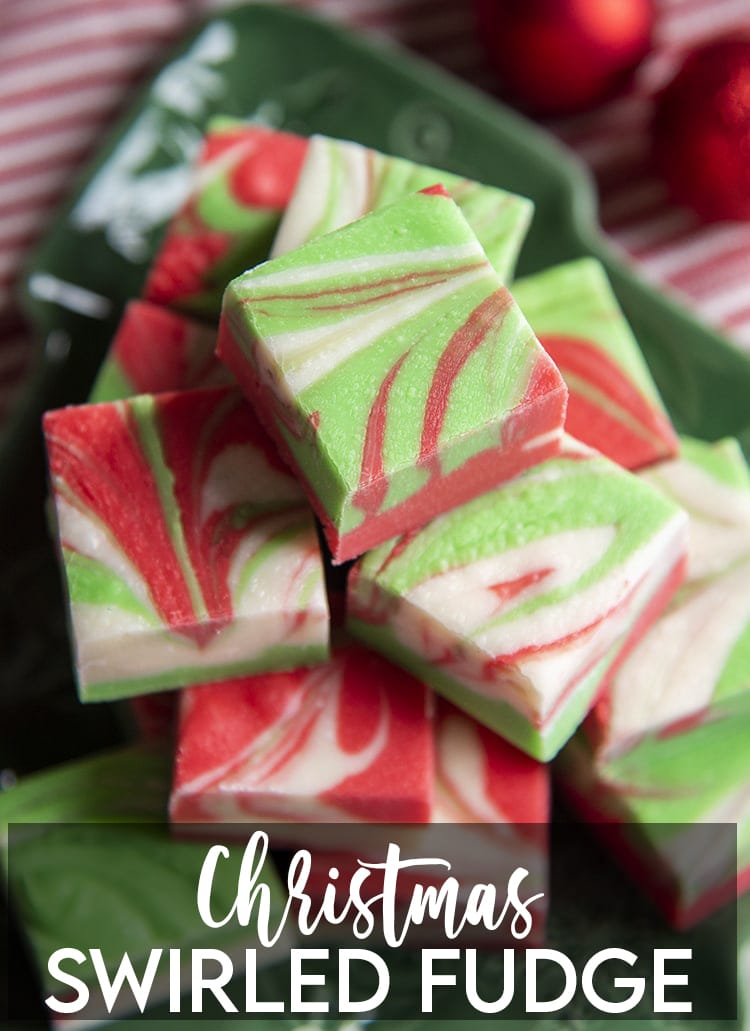 A pile of white chocolate microwave fudge, that is swirled with red and green colors throughout with a text overlay at the bottom for pinterest.