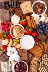 An overhead shot of a s'mores charcuterie board full of s'mores fixins.