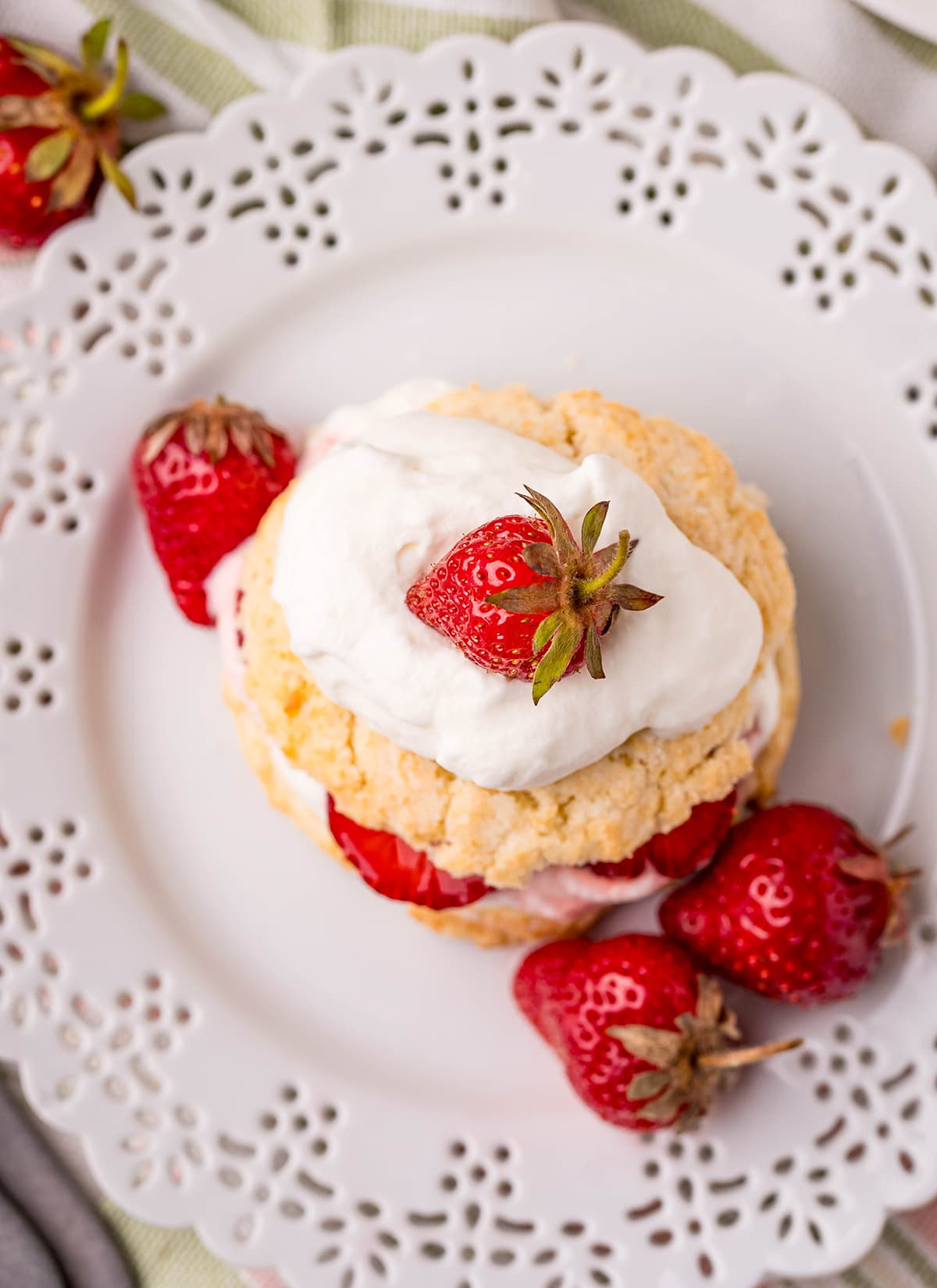 An overhead shot of a strawberry shortcake on a plate.
