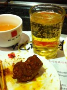 "Sichuan Food Groups: Tea, beer, and ""hĕn là niúròu"" (spiced beef wrapped around a whole red pepper, complete with seeds)."