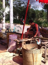 Bamboo being cut down to size. Its final destiny? Sticks of bamboo incense.