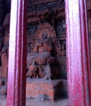 Religious grotto set into the mountainside staircase leading to the buddha's feet.