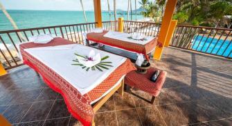 Rooftop massage beds overlooking the sea.