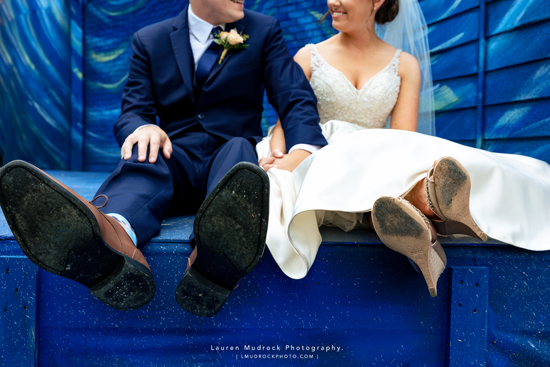 bride groom feet on blue stage