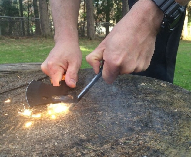 Using the hatchet to strike a ferro rod.