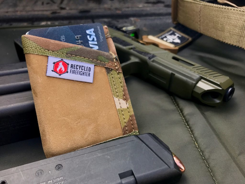 """I prefer to carry a slim wallet in my front pocket and opted for the """"Sergeant"""" model from Recycled Firefighter. Because of it's simple, durable design, this handmade recycled combat boot leather wallet has found it's way into my EDC. In addition, Recycled Firefighter offers traditional bifold wallets using various materials such as leather, hypalon and firehose. Some additional products include notebook covers, bags and EDC swag."""