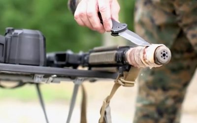 Marine Gunner Cooks Bacon on Hot Rifle Suppressor