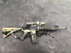 """Hybrid Carbine"" style rifle with Vortex 1-6 MRAD scope."