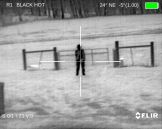 Man at 50 yards with pistol in right hand
