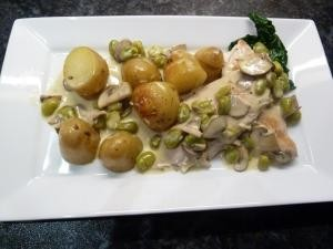 Chicken in a cider and cream sauce with broad beans and mushrooms