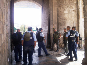 Israeli soldiers and police blocking Palestinians from one of the entrances to the old city in Jerusalem. Credit: Mel Frykberg/IPS