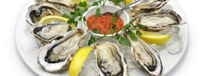 Raw Wellfleet oysters on plate