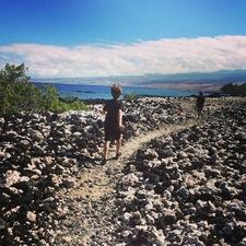 Black lava and white coral beach