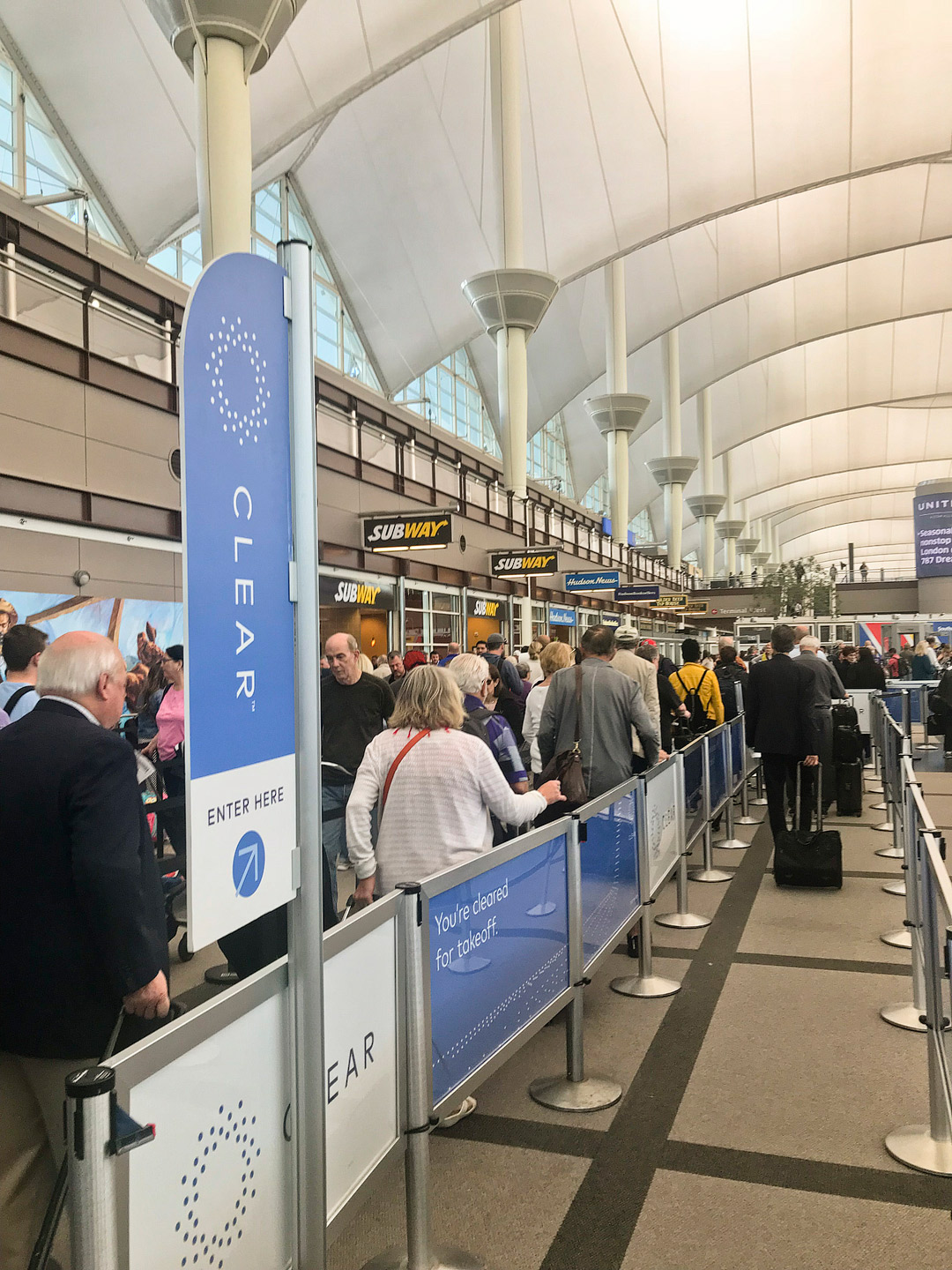Thinking about getting Clear? Save this pin and click through to see our guide on how to breeze through airport security like a boss the differences between Clearme vs TSA Precheck, how and where to apply for TSA Precheck and Clear, cost, and more // Local Adventurer #clear #airport #traveltips #localadventurer #travel #travelpro #travelblogger