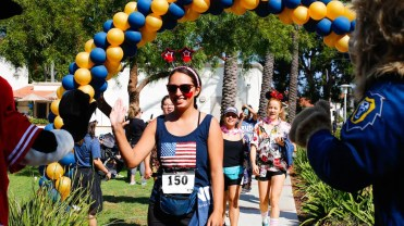 "Participants in the annual ""Run for Mercy 5K"" hosted by Vanguard University are celebrated as they cross the finish line on September 30 at the event that raised over $6,000 to support an alumni family and their two-year-old son, Noah, who has been diagnosed with Congenital Heart Disease."