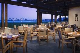 Catamaran_Oceana Coastal Kitchen_Patio_DuskBay