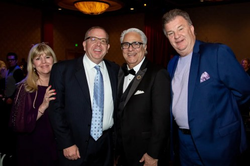 A longtime supporter of Illumination Foundation, the CEO of Habit Burger Russ Bendel, pictured far right, also provided a food truck to the evening's participating chefs as they readied for the event. Pictured from left to right, Judy Bendel, Dan Harley, Illumination Foundation Paul Leon, and Bendel.