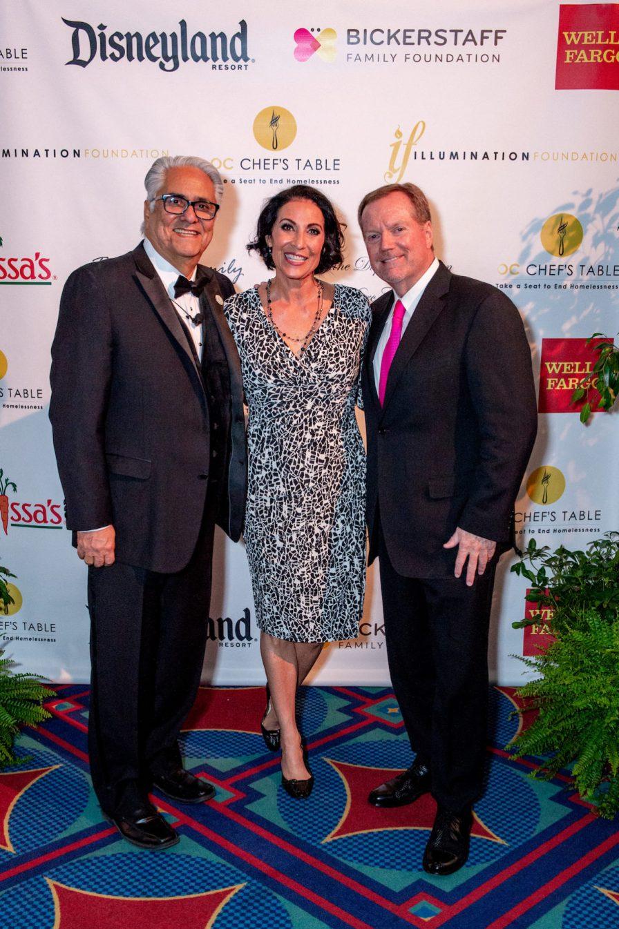 Illumination Foundation Paul Leon, left, welcomes Debbie and Glen Bickerstaff whose Bickerstaff Family Foundation was the OC Chef's Table Platinum sponsor with Disneyland® Resort.
