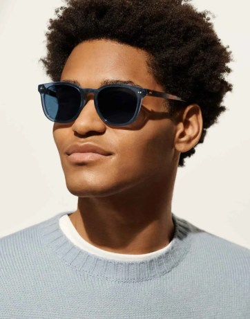 Toddy in Azure Crystal with Oak Barrel sunglasses starting at $95 with scratch-resistant lenses that block 100% of UV rays.
