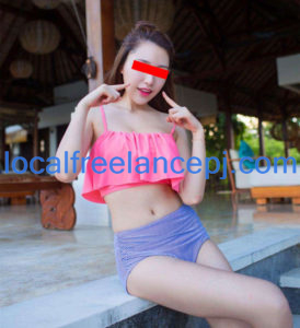 Escort Girl Huan Huan posing at rest area after swimming