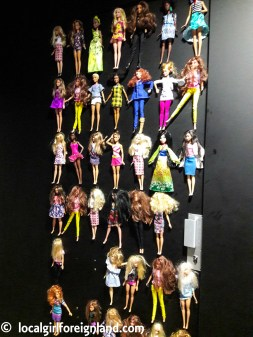 Ladies toilet door has barbies, La Felicità