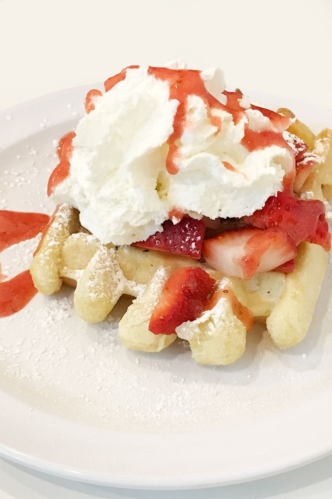 Liege waffle with strawberries and whipped cream one of the things we ate in Seattle