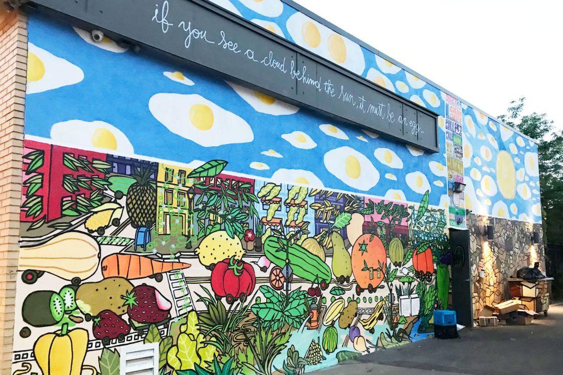 Mural of food on brick wall
