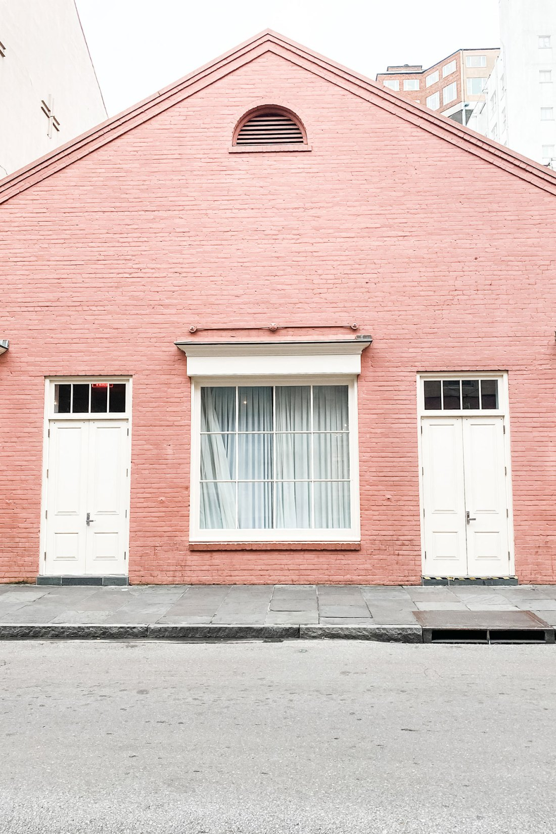 Pink building with white doors in New Orleans