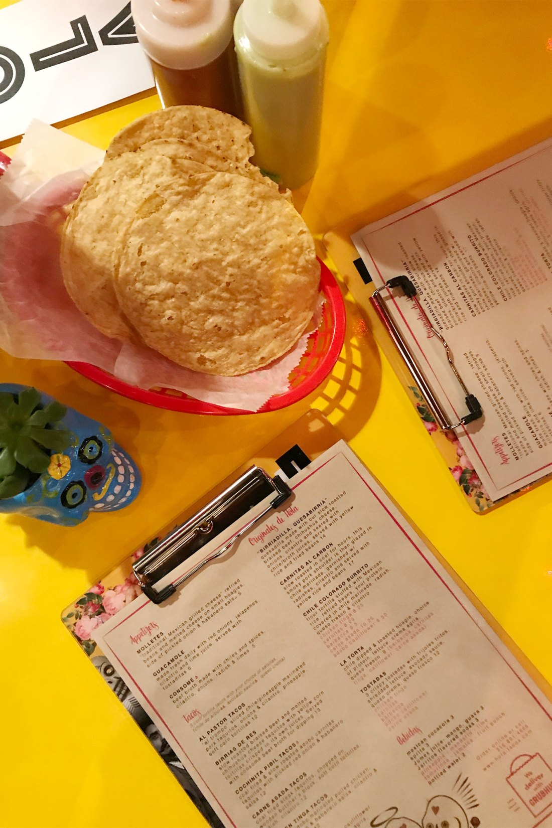 Menus on bright yellow table