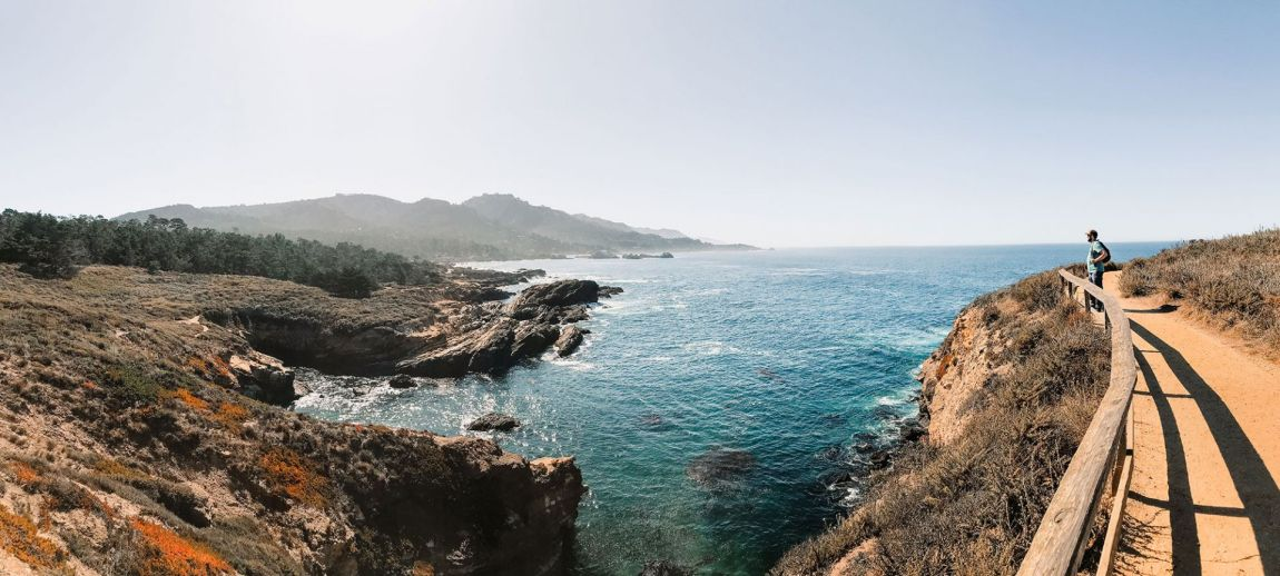 Man staring off into the ocean at Point Lobos | as seen on the Local Love and Wanderlust Blog