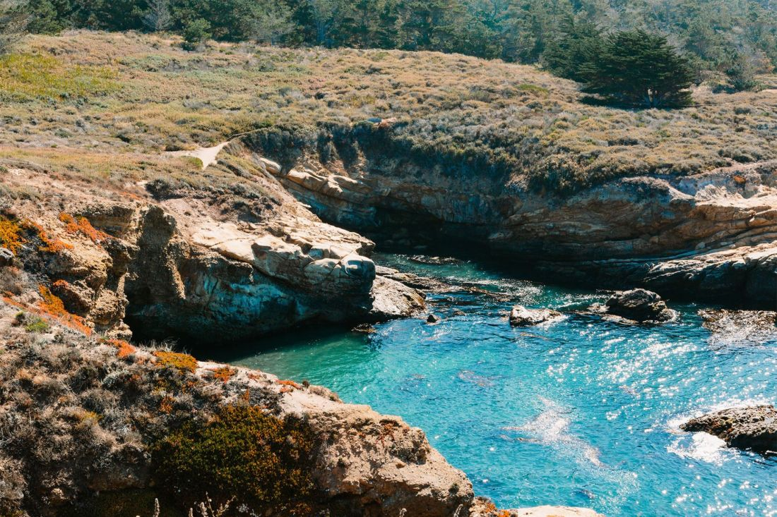 Turquoise waters inside a cove seen in Point Lobos | as seen on the Local Love and Wanderlust Blog