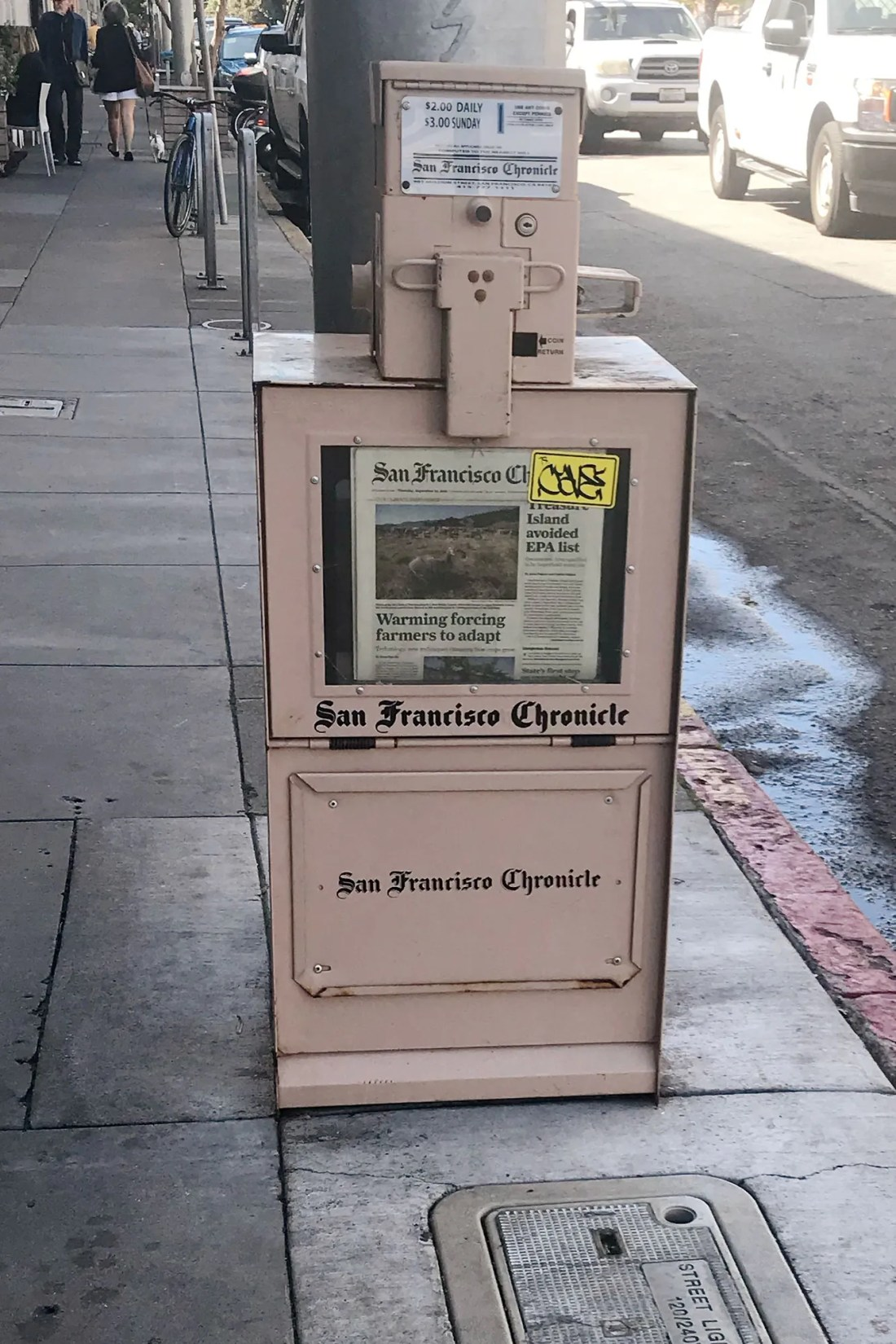Pink San Francisco Chronicle newspaper stand