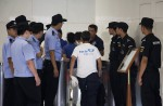 Anger and disbelief from MH370 China relatives over debris - 7