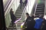 Crowded escalator in China shopping mall abruptly changes direction - 12