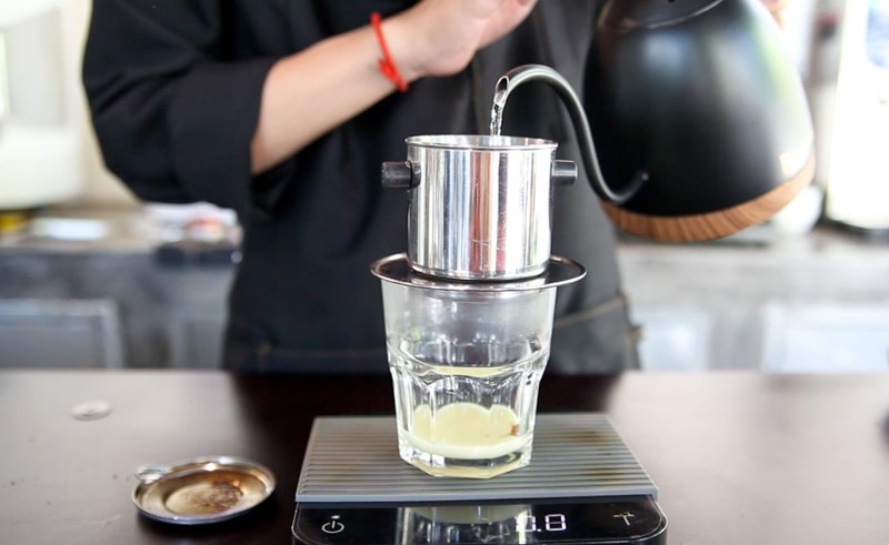 Fill your ca phe phin filter half way or  with 20 ml of hot water to brew your vietnamese coffee.