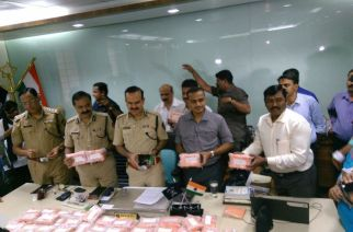 Thane police with seized items