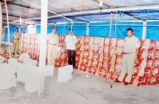 Police with the recovered beer cases