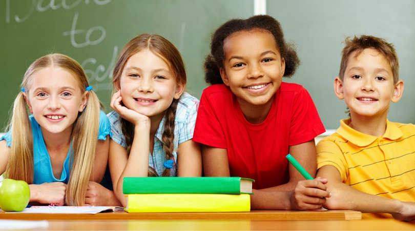 how to foster your child's development children in front of chalkboard back to school