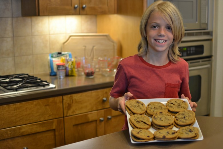 canaan-magness-9 boy showing cookies on a cookie sheet