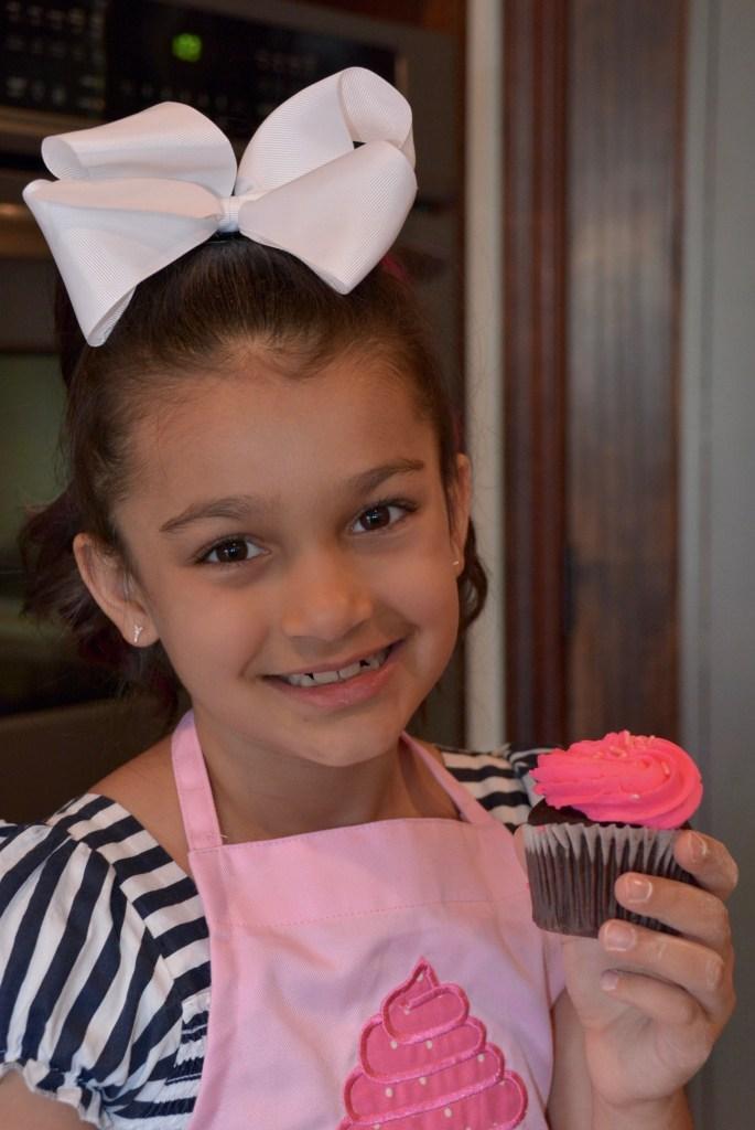 sofina-chishti-7 child chef holding a cupcake