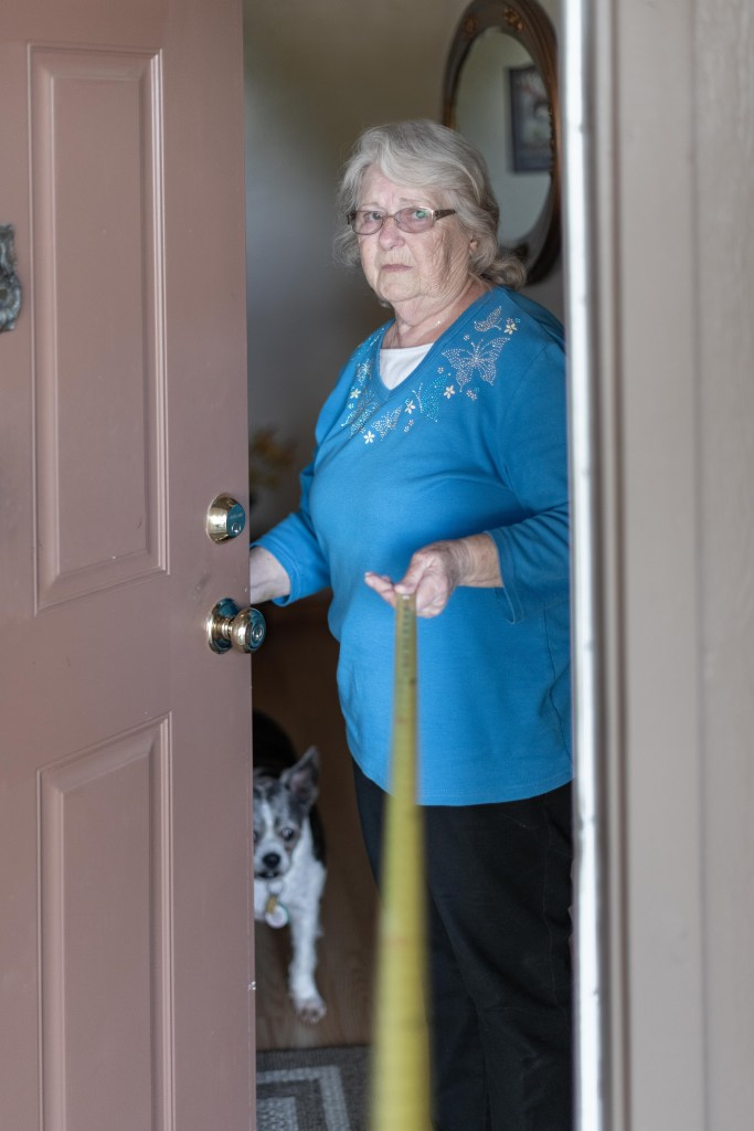 senior woman in her doorway