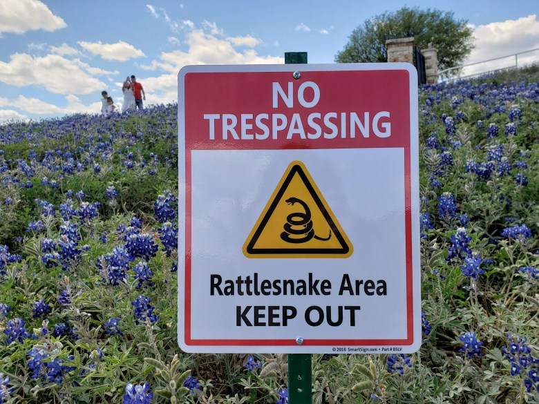 The new No Trespassing sign warns of rattlesnakes