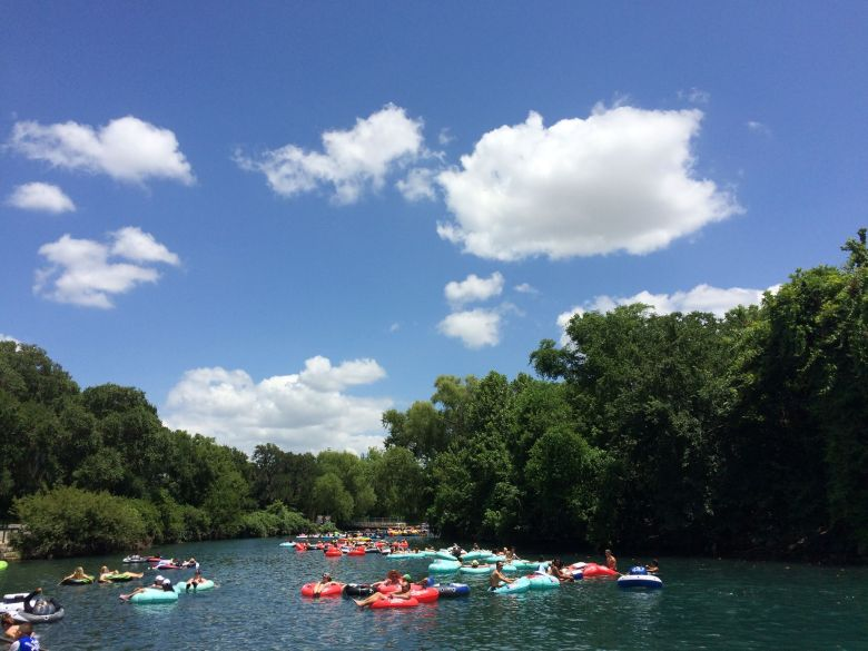 tubing in new braunfels, texas. image courtesy of play new braunfels on facebook | best texas getaways for summer