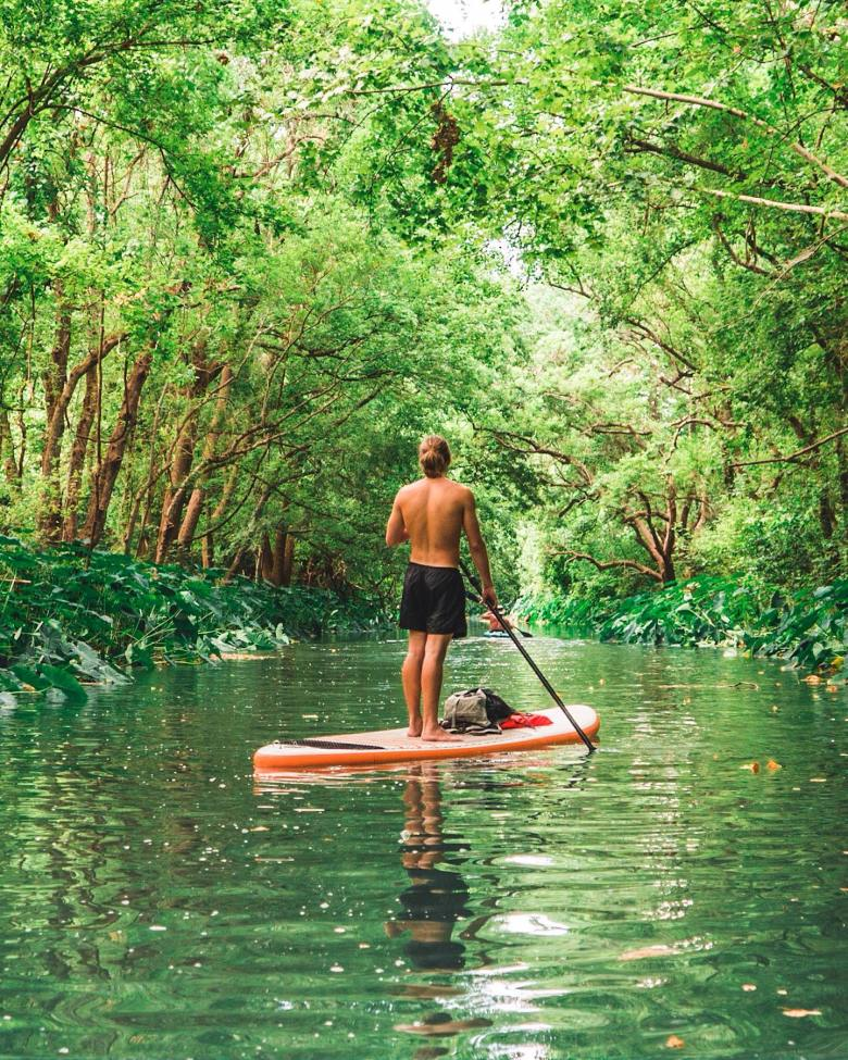 sup on the san marcos river, photo courtesy of paddle smtx on facebook | san marcos, best texas getaways