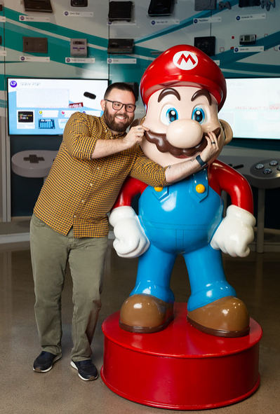 local influencer, brandon does dallas poses with mario at the national video game museum in frisco | image by alyssa vincent.  national video game museum is one of the best museums around.