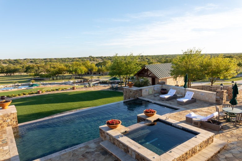 the pool overlooking the green at the jl bar ranch, resort & spa.